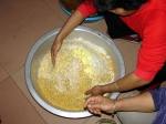 Hand mixing seasoned rice to make zong zi